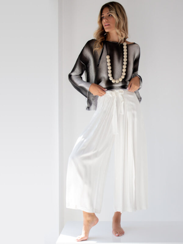 Sotris collection | Pleated flare trousers with wrap style layer